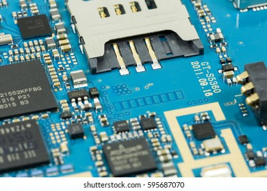 blue circuit board from smartphone with sim card slot