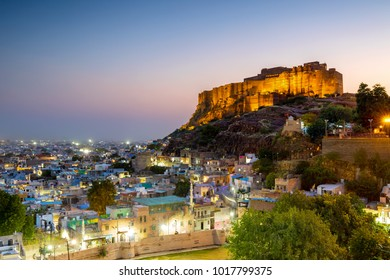 The Blue City and Mehrangarh Fort in Jodhpur at night. Rajasthan, India