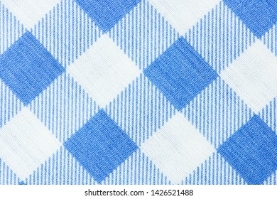 Blue classic checkered table cloth fabric background texture.