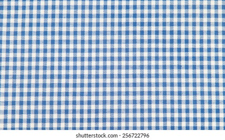 Blue classic checkered tablecloth texture, fabric background.
