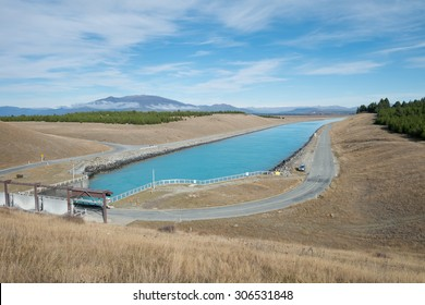 Blue Clean Canal or River with Floodgate in South Island, New Zealand