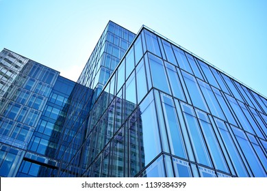 Blue clean glass wall of modern office building