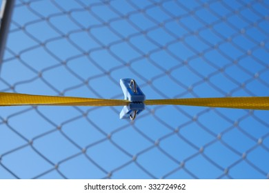 blue clip on the yellow rope