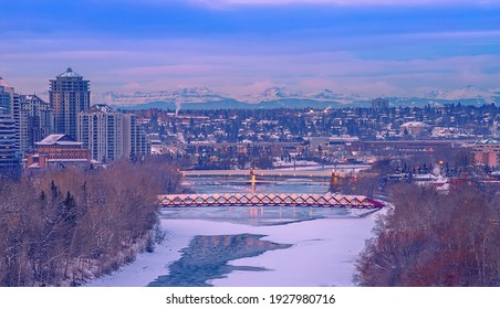 Blue clouds over a winter river valley in Calgary