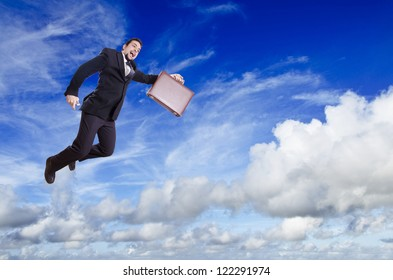 Blue cloudy sky and businessman flying