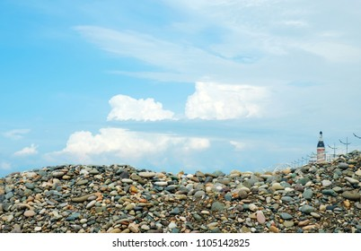 blue cloudy sky and colorful rocky ground