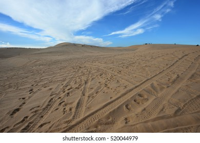 Blue cloudy sky over sand dunes in the evening