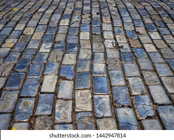 The blue cobblestones (adoquines in Spanish) brought over from England in 1784 pave the streets of all of Old San Juan in Puerto Rico. They were cast from iron slag, which is the waste from smelting.