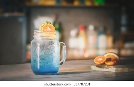 Blue cocktail drink on the bar counter.