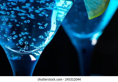 Blue cocktail in martini glasses on the bar table