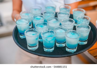 Blue cocktails shooter, shot at wedding reception