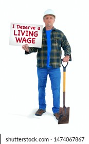 Blue collar construction worker man in a white hard hat with shovel doing manual labor holding a sign saying I Deserve a LIVING WAGE struggling to stay out of poverty on minimum wage.