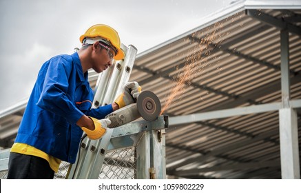 blue collar workers working in factory
