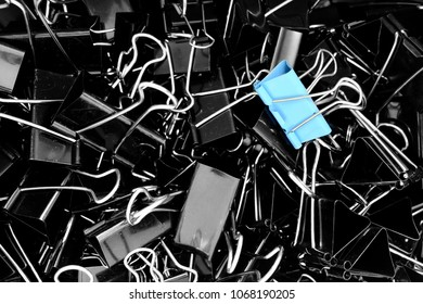 A blue color binder clip ,multi binder paper clip backgtound in black and white style.