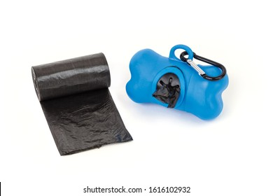 The blue color dispenser and pet dog waste black nylon roll pochette isolated on the white background. Compact size ultra-lightweight and it is designed with a hanging hook for convenient carrying.
