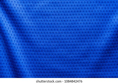 Blue color fabric sport clothing football jersey with air mesh texture background