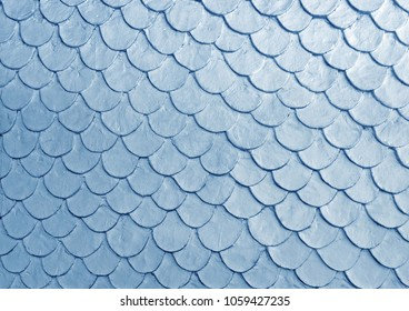 Blue color fish scale mortar plastering pattern on skin of wall in vintage old style