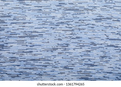 Blue colored knitted fabric textured background