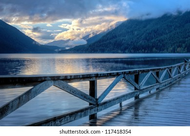 Blue colored lake landscape at sunset with pink cloudscape at Lake Crescent, Olympic National Park, Washington