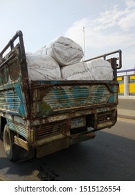 Blue Colored Mazda Truck Delivering raw towel rolls from one factory to another in Karachi Pakistan - Paksitan's biggest export is textile to US and EU. Sep 2019