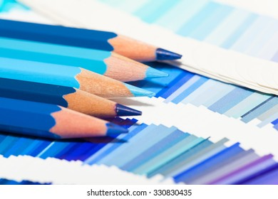 blue colored pencils and color chart of all colors