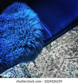 Blue colored sheep skin decorating a luxurious velvet sofa.