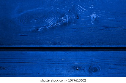 Blue colored wall from a natural wood. Texture and background. Design for exteriors and interiors