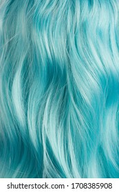 blue colored wig long curly hair texture background