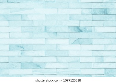 Blue colors and white brick wall art concrete stone texture background in wallpaper limestone abstract paint to flooring and homework/Brickwork or stonework clean grid uneven interior rock old.