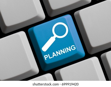 Blue Computer Keyboard with Magnifier Symbol showing Planning