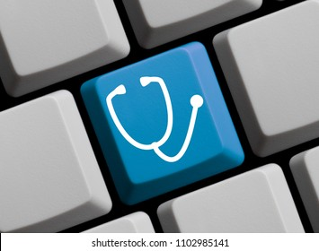 Blue Computer Keyboard showing Stehoscope for Telemedicine Concept