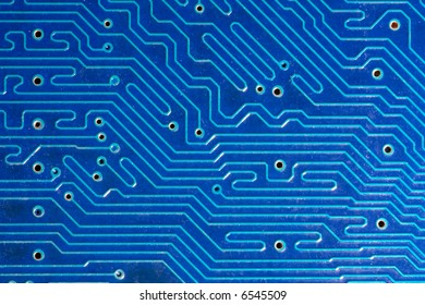 Blue computer motherboard with traces. Extremely close-up