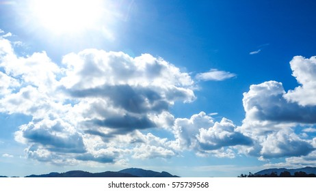 Blue concept: The Blue sky with so white cloud in the sunny day with the sun very bright.