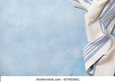 Blue concrete background (backdrop) with a napkin. view from above. Copy space