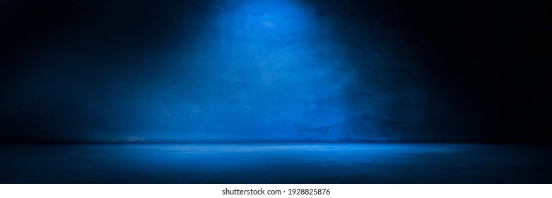 Blue concrete wall and floor with light and shadow backgrounds, use for product display for presentation and cover banner design.