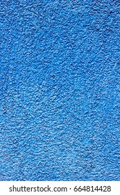 Blue concrete wall texture grained with sand.