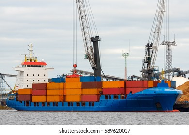 Blue container ship loading in cargo port of Europe