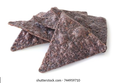 Blue corn tortilla chips on white background