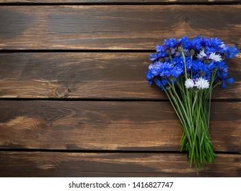 Blue Cornflower Herb on wooden surface
