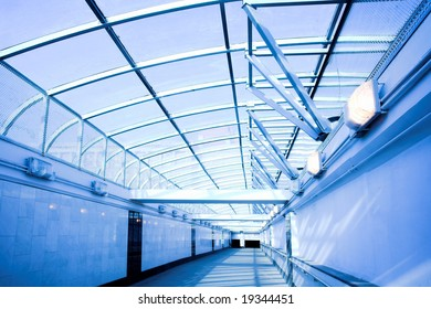 Blue corridor, people mooving near staircase