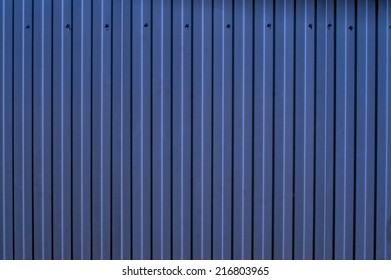Blue corrugated metal fence as a background