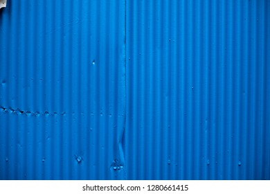Blue corrugated metal wall for background or texture