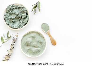 Blue cosmetic clay - face and body skin care - on white background top-down copy space