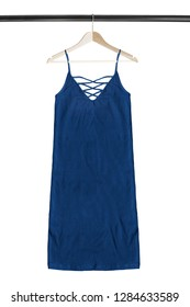Blue cotton sundress hanging on wooden clothes rack isolated over white