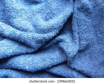 Blue cotton towel with wrinkles background