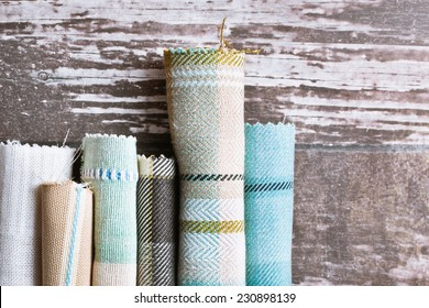 Blue and cream tartan fabric rolls