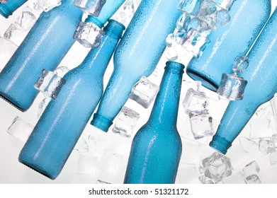 Blue creative bottles and clear ice .Cocktail with ice