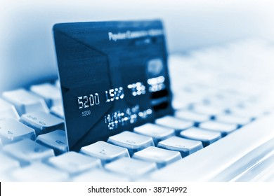 Blue credit card on a computer keyboard 03
