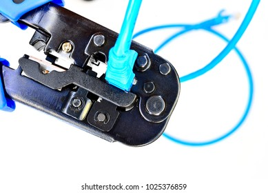 Blue Crimping tool with a computer network cable