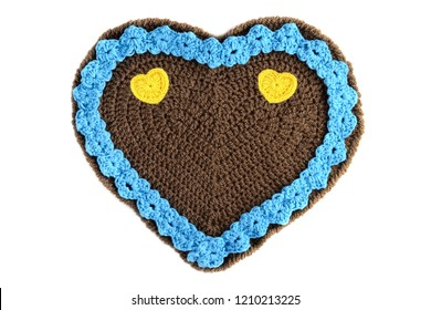 blue crochet gingerbread hearts for valentines day with floral ornaments and heart shapes.